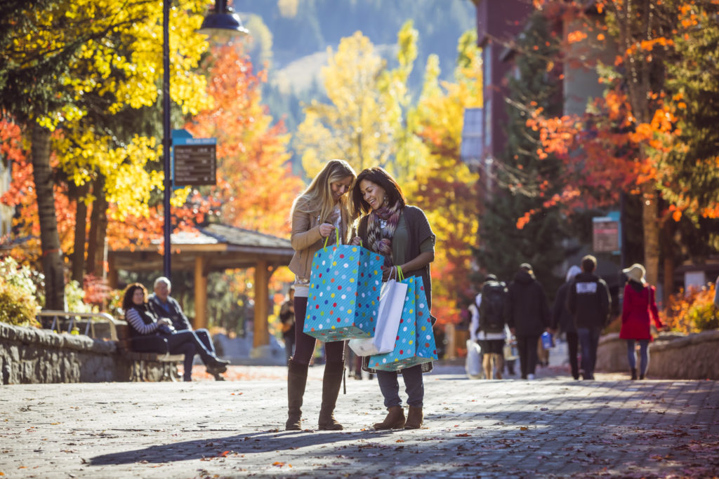 People enjoying Whistler village on a sunny fall day. PC: Justa Jeskova