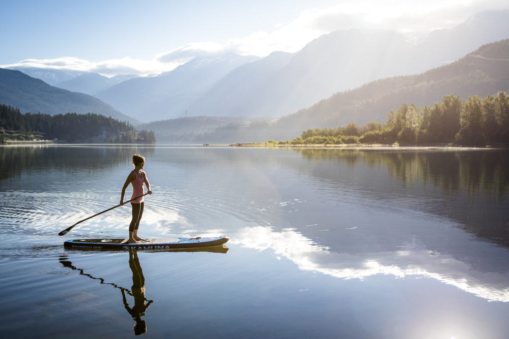 Try stand-up paddleboarding on Alta Lake. PC: Tourism Whistler/Justa Jeskova