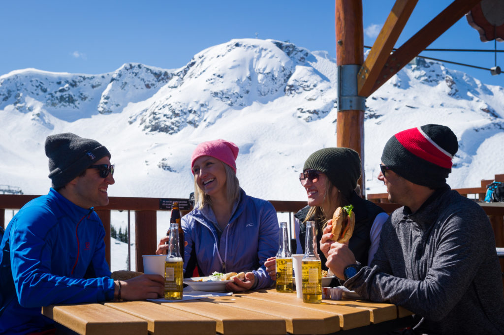 Enjoying the sun-drenched patio at the Roundhouse Lodge. PC: Tourism Whistler/Mike Crane